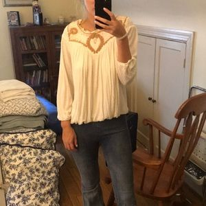 Cream top so cute with flare jeans!! Worn once